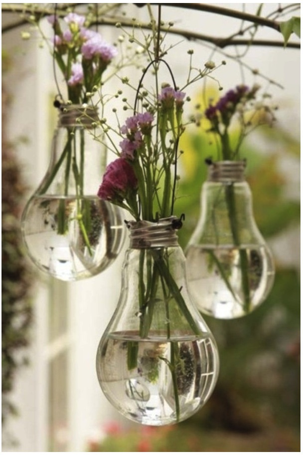 Recycled lightbulb vases with flowers