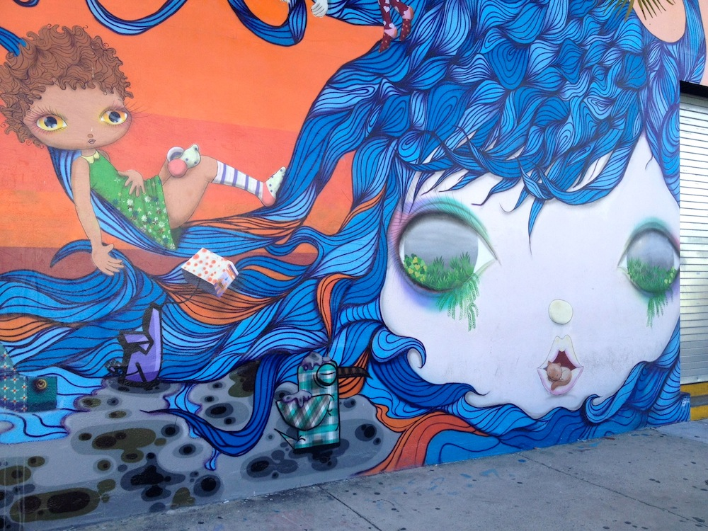 mural girl riding the waves of hair flow