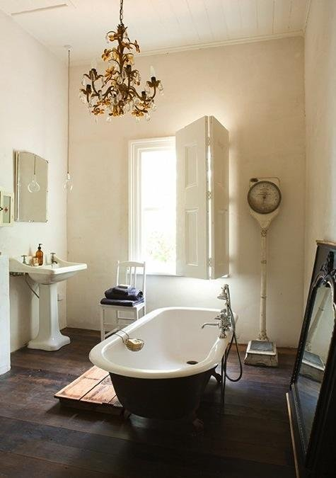 bathroom with light and claw foot tub
