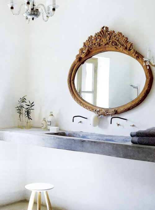gorgeous bathroom with mirror and concrete countertop