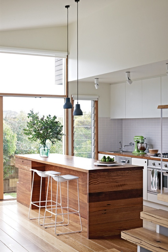 Light and spacious kitchen with natural  wood and lovely views. Photo by Mark Roper via dustjacketattic