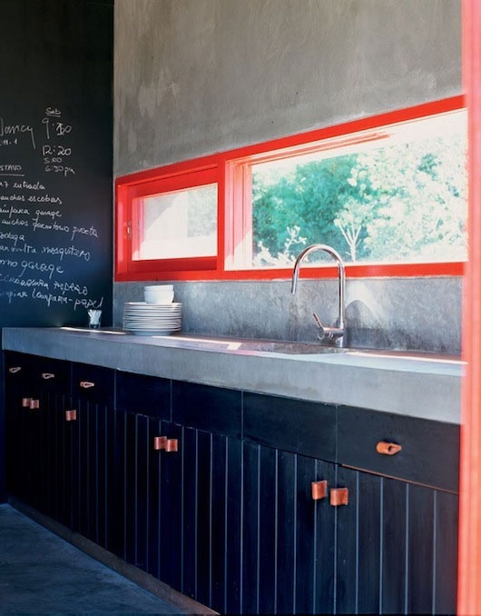Love the vibrant splashes of electric red. Kitchen by diego montero of studio m+. 19th century home in Uruguay. Photo via sfgirlbybay