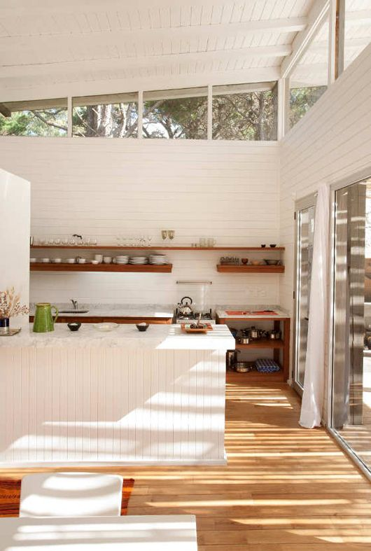 Love the clerestory windows, the spaciousness and natural wood floors in this Palm Springs Kitchen via sfgirlbybay
