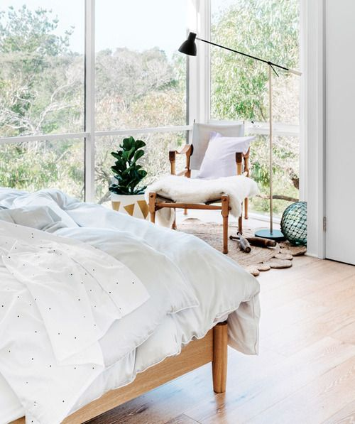 light filled bedroom with a view